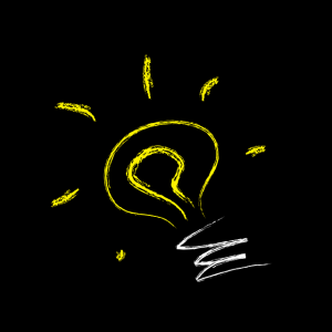 A cartoon yellow and white lightbulb on a black background